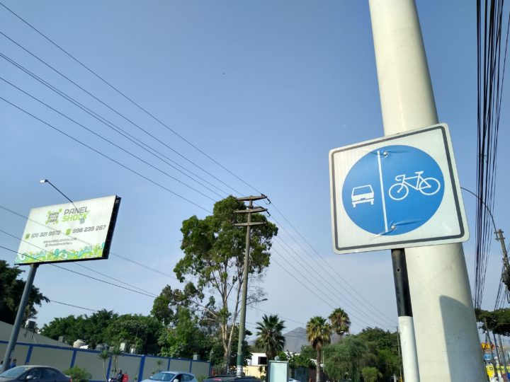 sign showing bike lanes next to lanes for vehicles